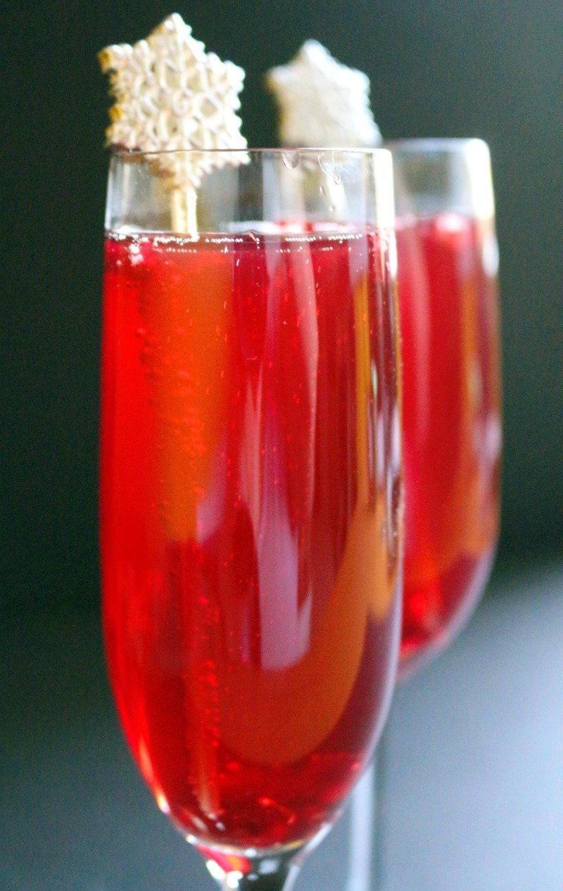 Day 3 of the 12 Days of Christmas Cocktails, A Bergamot Ruby French 75 with bergamot-infused pomegranate juice, dry gin, and champagne.
